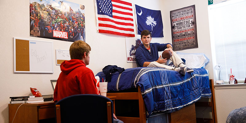Housing photo of two male students in dorm room